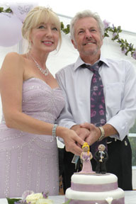 Photo of happy Christian Daters Jennie & David cutting their wedding cake