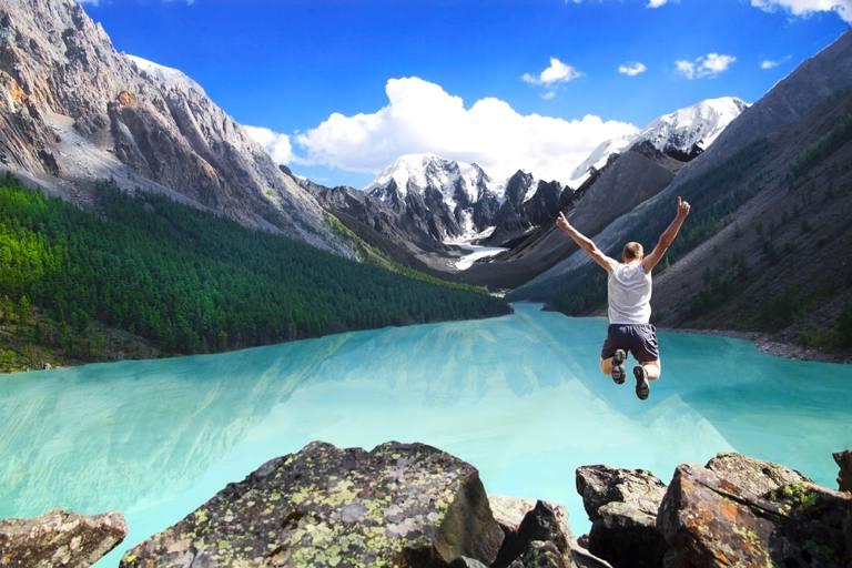 A man jumps of a high rock