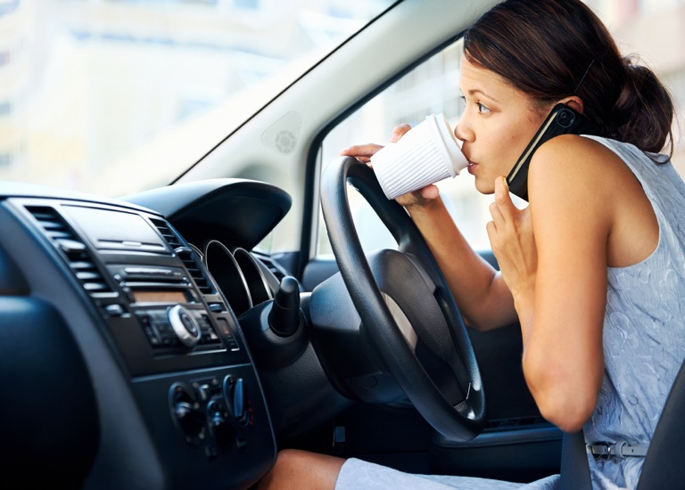 busy woman driving while on mobile