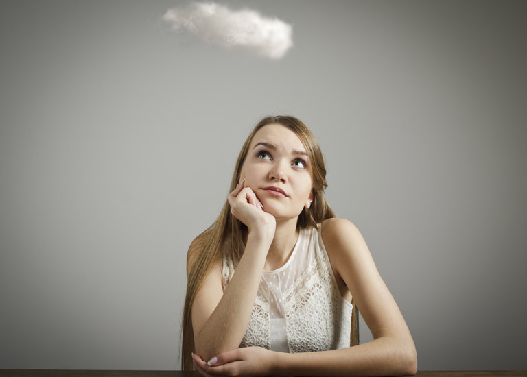 Girl thinking with a white cloud above her head
