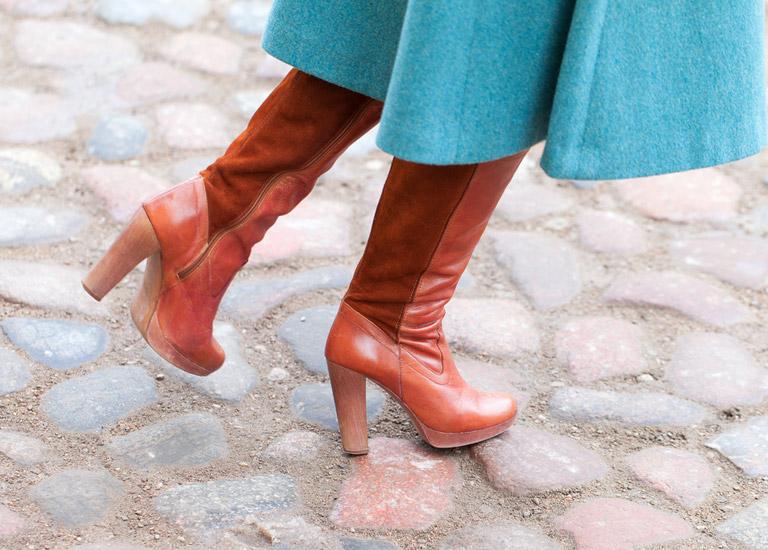 Woman walking along the pavement