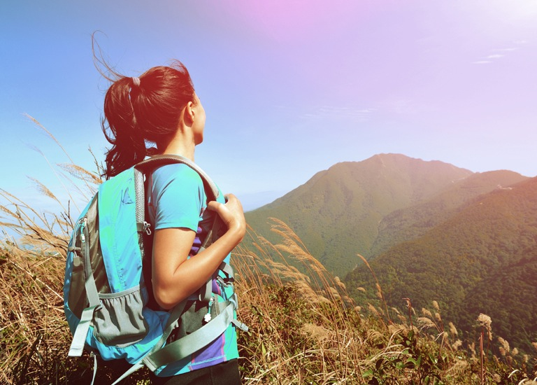single woman hiking
