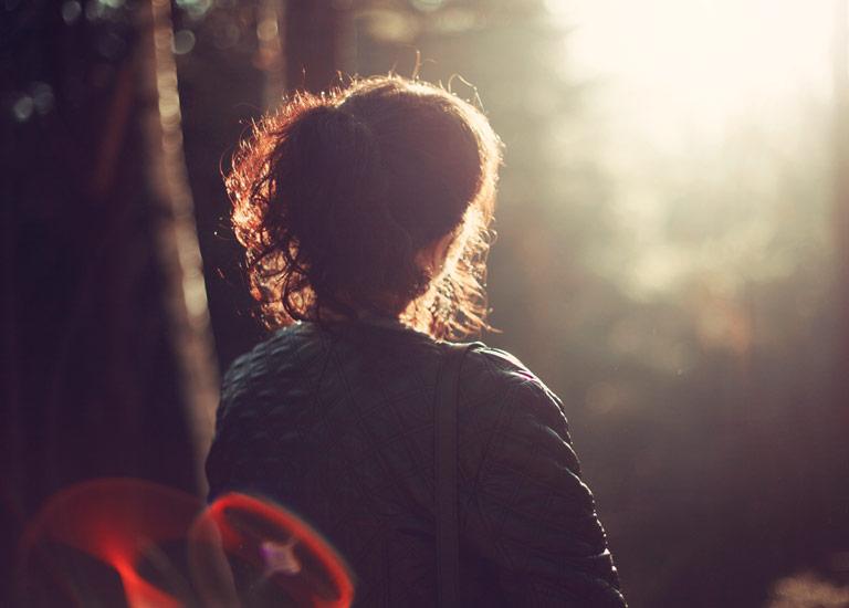 Girl thinking facing the sun