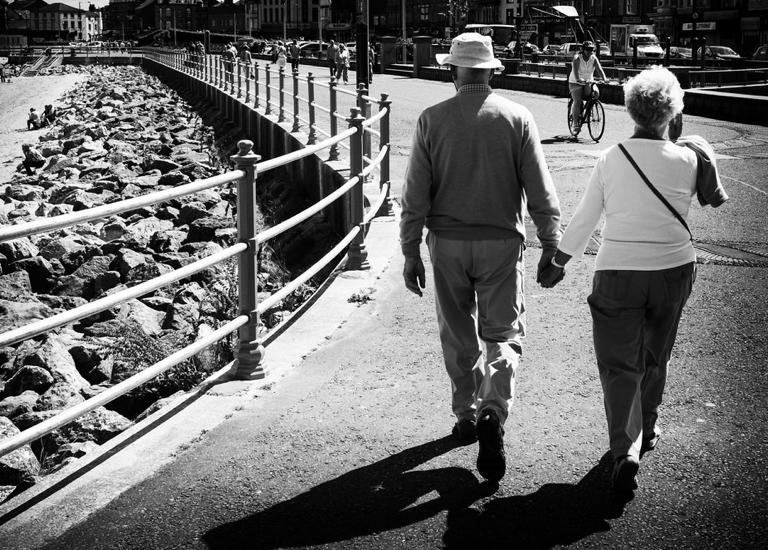 Elderly couple walking near beach