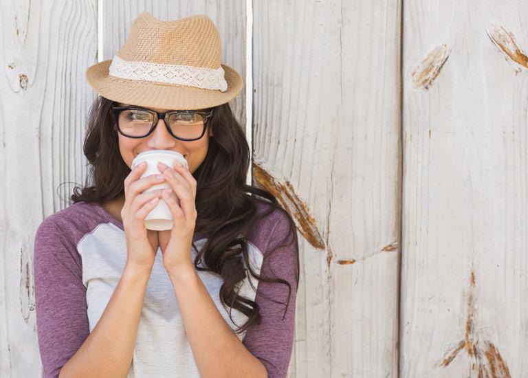 A woman drinking coffee