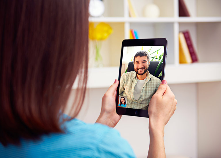 Man and woman talking via video chat
