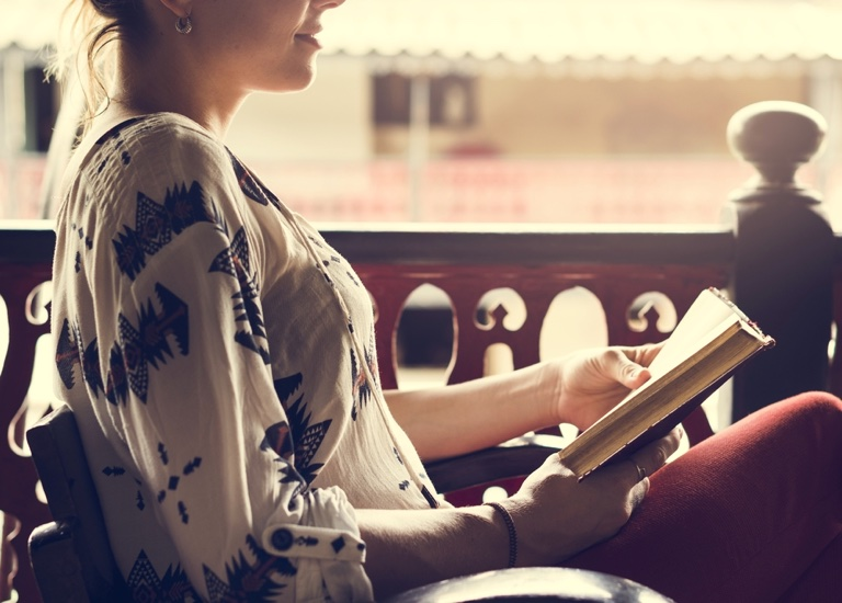 A woman sitting and reading