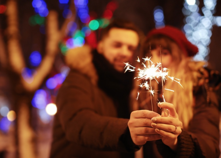 A couple holding a sparkler