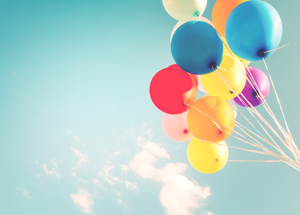 A bunch of balloons in the sky