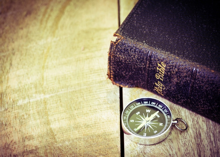 Image of a bible and compass