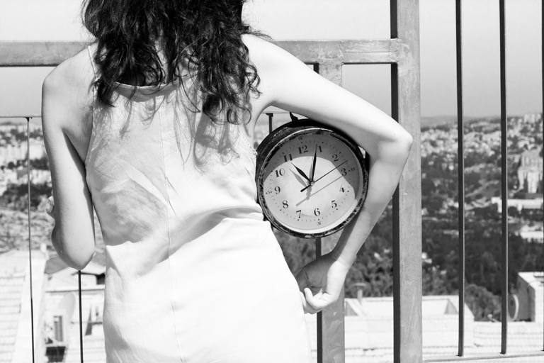 Girl with clock under her arm