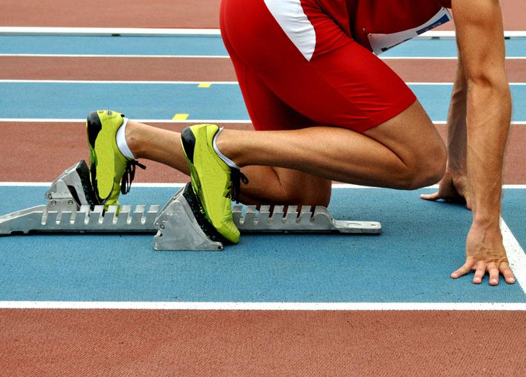Runner in starting blocks