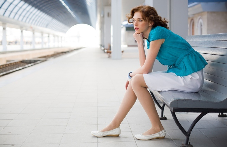 A women waiting at a train platform