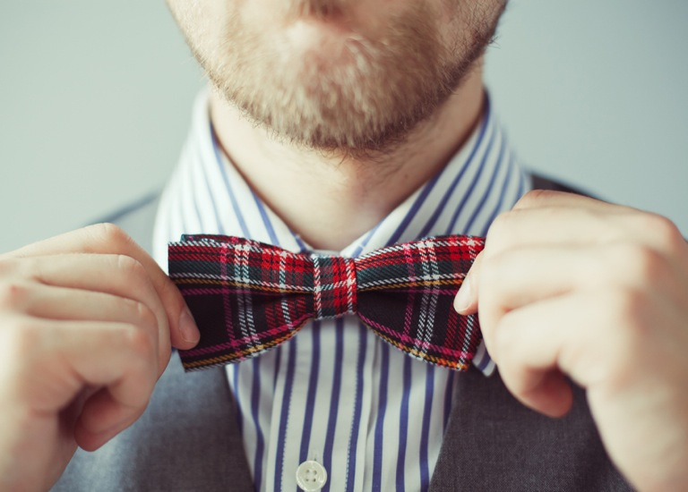 man fixing bow tie