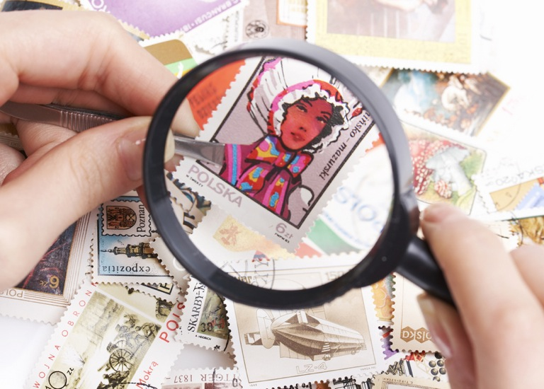 Stamp viewed via magnifying glass