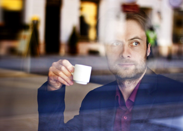 Man waiting in coffee shop
