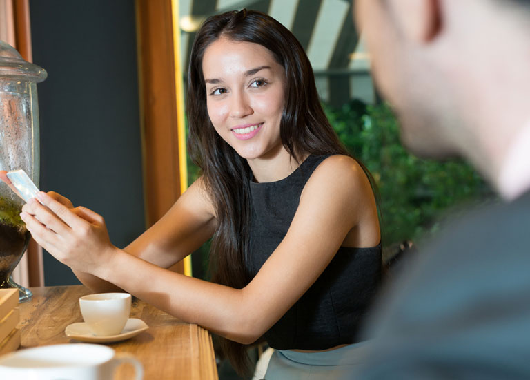 Woman talking to a man in a coffee shop