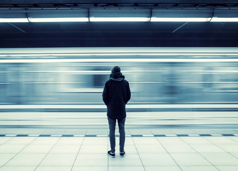 Man waiting on a train platform
