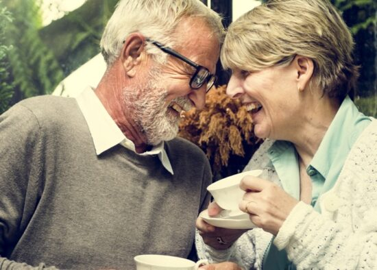 Senior couple drinking tea and laughing