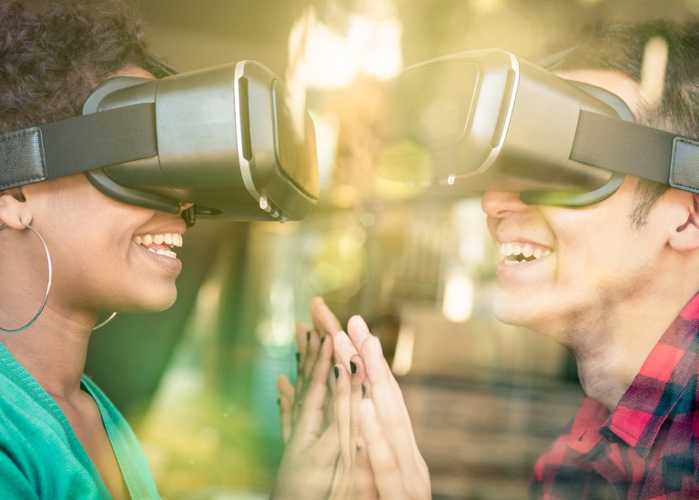 Two people on a date using virtual reality headsets
