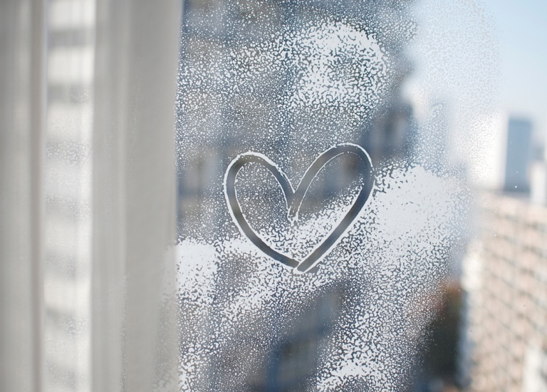 Heart shape drawn on a window