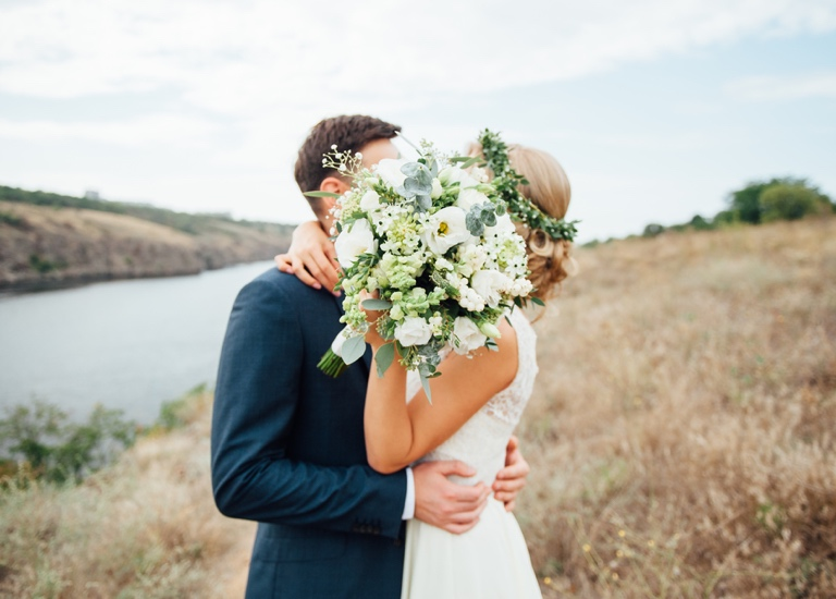 A couple embrace on their wedding day